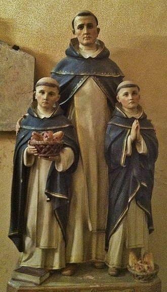 Statue du Bienheureux Bernard de Morlaàs avec les deux enfants - église Sainte-Foy de Morlaàs